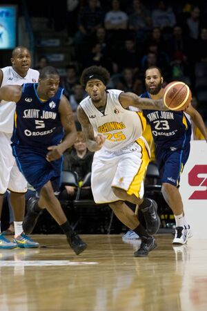 London Ontario, Canada - March 9, 2012. Gabe Freeman (25) of the London Lightning carries the ball up the court in game two of their best of three first round, the Ligthning won the first round of the playoffs defeating the Saint John Mill Rats 87-82 in f Stock Photo - 13073130