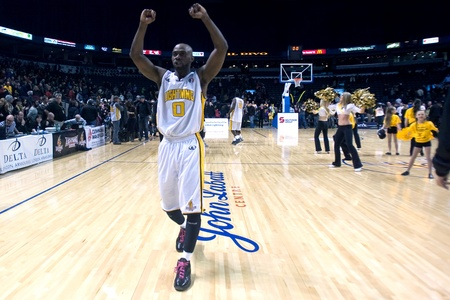 john labatt centre: London Ontario, Canada - March 9, 2012. DeAnthony Bowden walks off the court in victory in game two of their best of three first round, the Ligthning won the first round of the playoffs defeating the Saint John Mill Rats 87-82 in front of a record crowd o