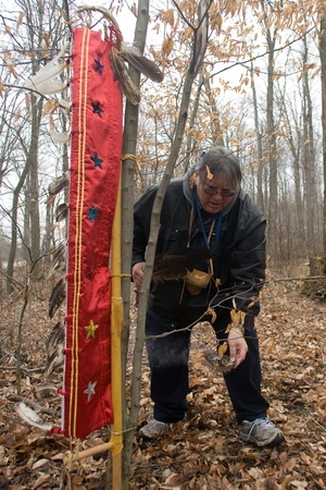 London Ontario, Canada - March 3, 2012. Dan Smoke smudges the Eagle Staff prior to the start of opening ceremonies at the Kinsmen Fanshawe Sugar Bush.  Stock Photo - 13073217