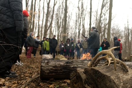 London Ontario, Canada - March 3, 2012. Deer antlers similar to one used by Canadain First Nation people rest on a stump by the fire as Dan Smoke leads opening ceremonies at the Kinsmen Fanshawe Sugar Bush.