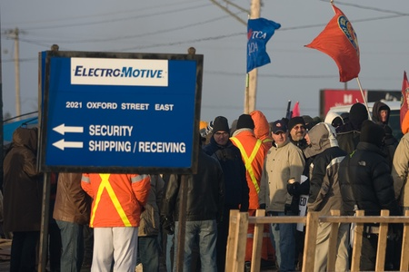 local 27: London Ontario, Canada - January 2, 2012. Canadian Auto Workers locked out from the Electro Motive factory in London walk a picket line in front of the factory. CAW Local 27 workers were locked out from the Electro Motive Diesel factory in London on Janua