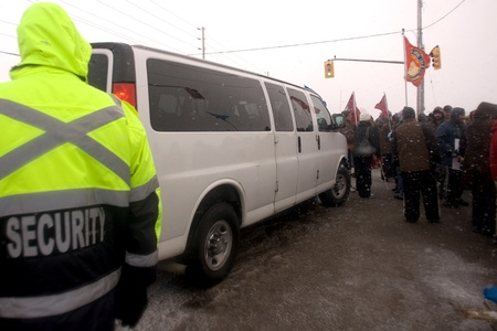 mot: London Ontario, Canada - January 2, 2012. Canadian Auto Workers locked out from the Electro Motive factory in London block a van suspected of carrying replacement workers from entering the factory. CAW Local 27 workers were locked out from the Electro Mot Editorial