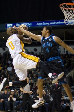 halifax rainmen: London Ontario, Canada - January 19, 2012. DeAnthony Bowden (0) of the London Lightning goes up for a basket against Joey Haywood (4) of the Halifax Rainmen in a regular season National Basketball League of Canada game between the first place London Light Editorial