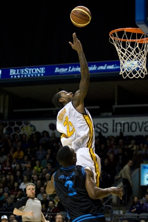 london lightning: London Ontario, Canada - January 19, 2012. Gabe Freeman (25) of the London Lightning goes up for a basket against Justin Johnson (3) of the Halifax Rainmen in a regular season National Basketball League of Canada game between the first place London Lightn