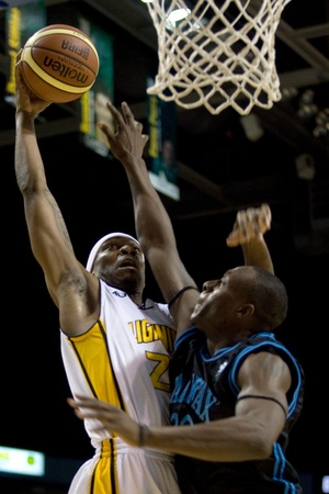 halifax rainmen: London Ontario, Canada - January 19, 2012. Tim Ellis goes up for a basket in a regular season National Basketball League of Canada game between the first place London Lightning and second place Halifax Rainmen.  The Lightning defeated the Rainmen by a sco