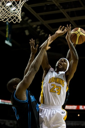 london lightning: London Ontario, Canada - January 19, 2012. Tiim Ellis of the London Lightning goes up for a basket but has the ball stripped from him in a regular season National Basketball League of Canada game between the first place London Lightning and second place H Editorial