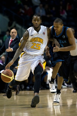 london lightning: London Ontario, Canada - January 19, 2012. Gabe Freeman of the London Lightning carries the ball up the court in a regular season National Basketball League of Canada game between the first place London Lightning and second place Halifax Rainmen.  The Lig