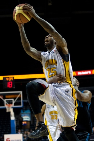 london lightning: London Ontario, Canada - January 19, 2012. Gabe Freeman goes up for a basket and is fouled in a regular season National Basketball League of Canada game between the first place London Lightning and second place Halifax Rainmen.  The Lightning defeated the