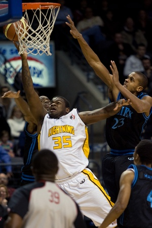 london lightning: London Ontario, Canada - January 19, 2012. London Lightning player Shamari Spears (35) goes up for a basket in a regular season National Basketball League of Canada game between the first place London Lightning and second place Halifax Rainmen.  The Light