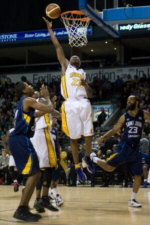 john labatt centre: London Ontario, Canada - March 9, 2012. Tim Ellis (23) of the London Lightning goes up for a basket in game two of their best of three first round, the Ligthning won the first round of the playoffs defeating the Saint John Mill Rats 87-82 in front of a re