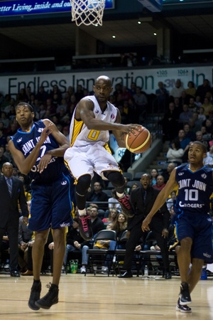 London Ontario, Canada - March 9, 2012. DeAnthony Bowden (0) of the London Lightning drives between Jermaine Blackburn (22) and Darren Duncan (10) and looks for a pass in game two of their best of three first round, the Ligthning won the first round of th Stock Photo - 13073164