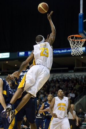 playoffs: London Ontario, Canada - March 9, 2012. Tim Ellis (23) of the London Lightning soars towards the basket in game two of their best of three first round, the Ligthning won the first round of the playoffs defeating the Saint John Mill Rats 87-82 in front of