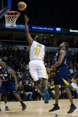 playoffs: London Ontario, Canada - March 9, 2012. Brandon Dean (11) of the London Lightning soars towards the basket in game two of their best of three first round, the Ligthning won the first round of the playoffs defeating the Saint John Mill Rats 87-82 in front