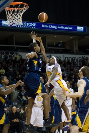 john labatt centre: London Ontario, Canada - March 9, 2012. Tim Ellis (23) of the London Lightning follows his shot as he goes up for a basket in game two of their best of three first round, the Ligthning won the first round of the playoffs defeating the Saint John Mill Rats