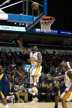 playoffs: London Ontario, Canada - March 9, 2012. Eddie Smith (20) of the London Lightning follow his shot in game two of their best of three first round, the Ligthning won the first round of the playoffs defeating the Saint John Mill Rats 87-82 in front of a recor