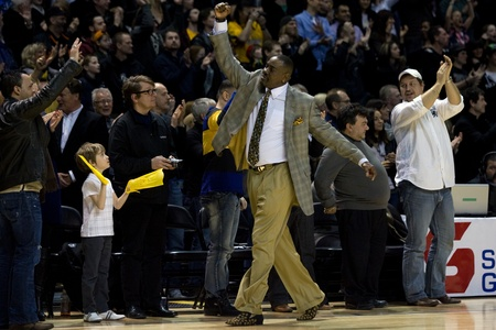 playoffs: London Ontario, Canada - March 9, 2012. Michael Ray Richardson head coach of the London Lightning celebrates after the Ligthning won the first round of the playoffs defeating the Saint John Mill Rats 87-82 in front of a record crowd of 3919 at the John La Editorial