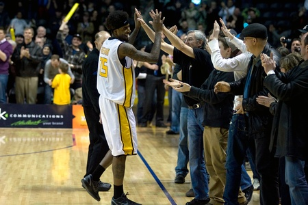 london lightning: London Ontario, Canada - March 9, 2012. Fan favourite Gabe Freeman of the London Lightning celebrates with fans along the sidelines after the Ligthning won the first round of the playoffs defeating the Saint John Mill Rats 87-82 in front of a record crowd Editorial