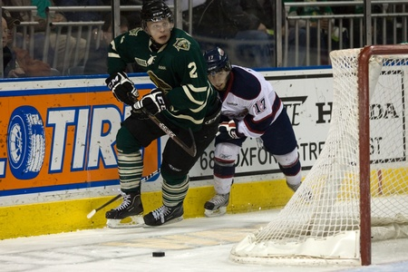 l first: London Ontario, Canada - April 9, 2012. Olli Maatta (2) of the London Knights eludes a check from Saginaw Spirit player Carlos Amestoy (17) in the first period of the third game against the Saginaw Spirit. London won the game ?? to ?? played at the John L