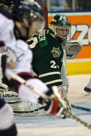 London Ontario, Canada - April 9, 2012. Michaeal Houser, goalie for the London Knights keeps an eye on the play around his net in the third period against the Saginaw Spirit. Saginaw defeated London 5-2 to take a 2-1 lead in the best of seven playoff seri Editorial