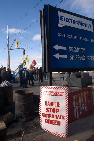 London Ontario, Canada - February 4, 2012. One day after learning they jobs were gone and factory that had been open for more than 60 years was to be closed, workers at the Electro Motive plant continued their picket. The Canadian Auto Workers Union has s