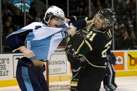 majors: London Ontario, Canada - February 4, 2012. Trevor Carrick of the Majors (4) and Tyler Ferry (21) of the Knights fight it out in a Ontario Hockey League game between the London Knights and the Mississauga St. Michaels Majors. London won the game 5-2.