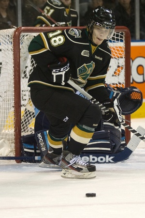 majors: London Ontario, Canada - February 4, 2012. Knight forward Vladislav Namestnikov (18) eyes the puck in a Ontario Hockey League game between the London Knights and the Mississauga St. Michaels Majors. London won the game 5-2.  Editorial