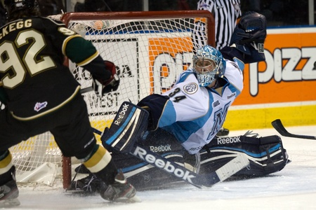 maxwell: London Ontario, Canada - February 4, 2012. Majors goalie Brandon Maxwell makes a save on Brett McKegg of the Knights in a Ontario Hockey League game between the London Knights and the Mississauga St. Michaels Majors. London won the game 5-2.