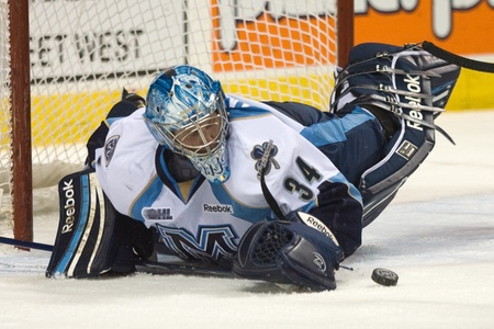 maxwell: London Ontario, Canada - February 4, 2012. Brandon Maxwell of the Majors makes a save in a Ontario Hockey League game between the London Knights and the Mississauga St. Michaels Majors. London won the game 5-2.  Editorial