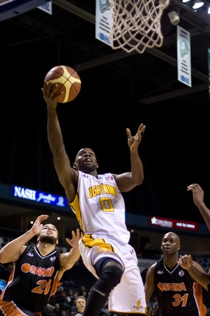 london lightning: London Ontario, Canada - February 5, 2012. DeAnthony Bowden (0) of the London Lightning goes up for basket during a National Basketball League of Canada game between the London Lightning and the Oshawa Power. London won the game 129 to 117 in overtime at