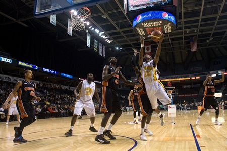london lightning: London Ontario, Canada - February 5, 2012. Eddie Smith (20) of the London Lightning goes up for basket during a National Basketball League of Canada game between the London Lightning and the Oshawa Power. London won the game 129 to 117 in overtime at the
