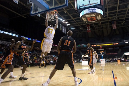 London Ontario, Canada - February 5, 2012. Tim Ellis (23) of the London Lightning goes up for basket during a National Basketball League of Canada game between the London Lightning and the Oshawa Power. London won the game 129 to 117 in overtime at the Jo