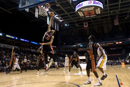 london lightning: London Ontario, Canada - February 5, 2012. Morgan Lewis (20) of the Oshawa Power goes up for a rebound during a National Basketball League of Canada game between the London Lightning and the Oshawa Power. London won the game 129 to 117 in overtime at the