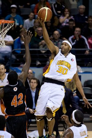john labatt centre: London Ontario, Canada - February 5, 2012. Eddie Smith (20) of the London Lightning goes up for basket during a National Basketball League of Canada game between the London Lightning and the Oshawa Power. London won the game 129 to 117 in overtime at the