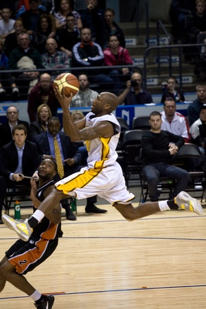 London Ontario, Canada - February 5, 2012. Eddie Smith (20) of the London Lightning goes up for basket during a National Basketball League of Canada game between the London Lightning and the Oshawa Power. London won the game 129 to 117 in overtime at the