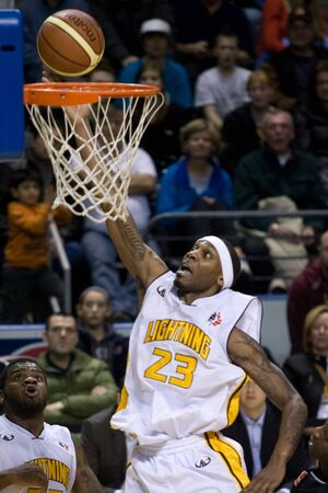 john labatt centre: London Ontario, Canada - February 5, 2012. Tim Ellis (23) of the London Lightning goes up for basket during a National Basketball League of Canada game between the London Lightning and the Oshawa Power. London won the game 129 to 117 in overtime at the Jo