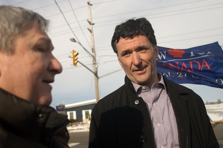 London Ontario, Canada - January 6, 2012. Paul Dewar, NDP MP - Ottawa Centre, right speaks with Tim Wilkes from CAW Local 27 about the ongoing labour dispute at the Electro Motive factory in London. Electro Motive workers were locked out by the parent com Stock Photo - 13118937