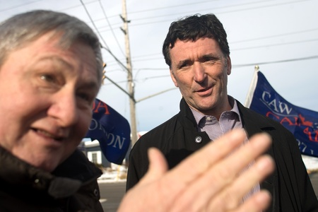 local 27: London Ontario, Canada - January 6, 2012. Paul Dewar, NDP MP - Ottawa Centre, right, listens to Tim Wilkes from CAW Local 27 as they talk about the ongoing labour dispute at the Electro Motive factory in London. Electro Motive workers were locked out by t Editorial