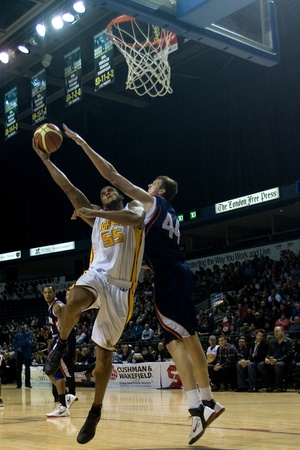 john labatt centre: London Ontario, Canada - January 6, 2012. Braxton Dupree (55) of the London Lightning attemps a basket against Jared Carter (44) of the Summerside Storm in a National Baskeball League of Canada game between the London Lightning and the Summerside Storm. L