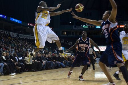 London Ontario, Canada - January 6, 2012. Eddie Smith (20) of the London Lightning makes a pass in a National Baskeball League of Canada game between the London Lightning and the Summerside Storm. London won the game 106-98. Editorial