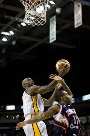 john labatt centre: London Ontario, Canada - January 6, 2012. DeAnthony Bowden (0) of the London Lightning goes up for a basket in a National Baskeball League of Canada game between the London Lightning and the Summerside Storm. London won the game 106-98. Editorial