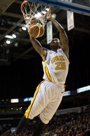 john labatt centre: London Ontario, Canada - January 6, 2012. Gabe Freeman (25) of the London Lightning goes up for basket in a National Baskeball League of Canada game between the London Lightning and the Summerside Storm. London won the game 106-98.