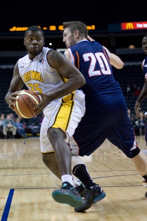London Ontario, Canada - January 6, 2012. Shamaari Spears (35) of the London Lightning cuts around Doug McKinney (20) of the Summerside Storm in a National Baskeball League of Canada game between the London Lightning and the Summerside Storm. London won t Editorial