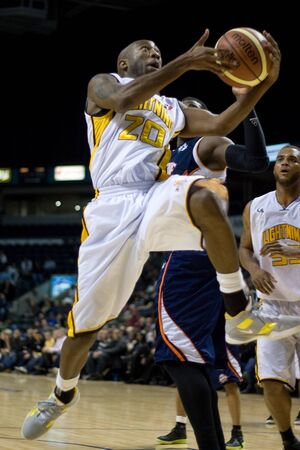 john labatt centre: London Ontario, Canada - January 6, 2012. Eddie Smith (20) of the London Lightning goes up for a basket in a National Baskeball League of Canada game between the London Lightning and the Summerside Storm. London won the game 106-98. Editorial