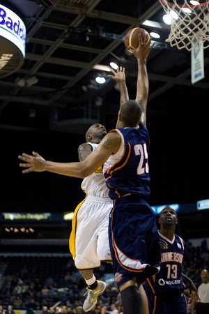 john labatt centre: London Ontario, Canada - January 6, 2012. Jessan Gray (25) of the Summerside Storm goes up to block a shot by Eddie Smith (20) of the London Lightning in a National Baskeball League of Canada game between the London Lightning and the Summerside Storm. Lon