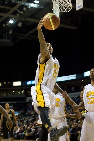 london lightning: London Ontario, Canada - January 7, 2012. Gabe Freeman of the London Lightning stretches for a rebound during a National Basketball League of Canada game between the London Lightning and the Halifax Rainmen. The Rainmen were forced to wear the Lightning`s