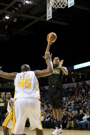 London Ontario, Canada - January 7, 2012. A Halifax Rainmen players goes up for a shot during a National Basketball League of Canada game between the London Lightning and the Halifax Rainmen. The Rainmen were forced to wear the Lightning`s practice jersey