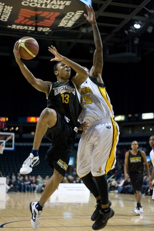 london lightning: London Ontario, Canada - January 7, 2012. Joey Haywood (13) of the Halifax Rainmen goes up for shot against Gabe Freeman from the London Lightning during a National Basketball League of Canada game between the London Lightning and the Halifax Rainmen. The