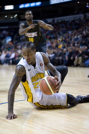 john labatt centre: London Ontario, Canada - January 7, 2012. Gabe Freeman of the London Lightning recovers after a fall during a National Basketball League of Canada game between the London Lightning and the Halifax Rainmen. The Rainmen were forced to wear the Lightning`s p Editorial