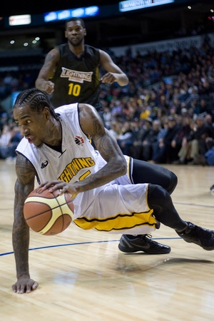 halifax rainmen: London Ontario, Canada - January 7, 2012. Gabe Freeman of the London Lightning recovers from a fall during a National Basketball League of Canada game between the London Lightning and the Halifax Rainmen. The Rainmen were forced to wear the Lightning`s pr Editorial