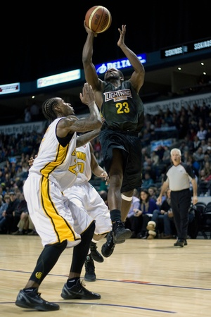london lightning: London Ontario, Canada - January 7, 2012. Chris Hagen (23) of the Halifax Rainmen goes up for a basket during a National Basketball League of Canada game between the London Lightning and the Halifax Rainmen. The Rainmen were forced to wear the Lightning`s